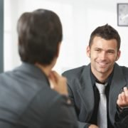A business man talking with a woman about outpatient treatment.